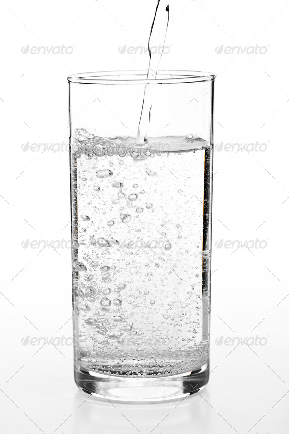 pouring water to a glass - Stock Photo - Images