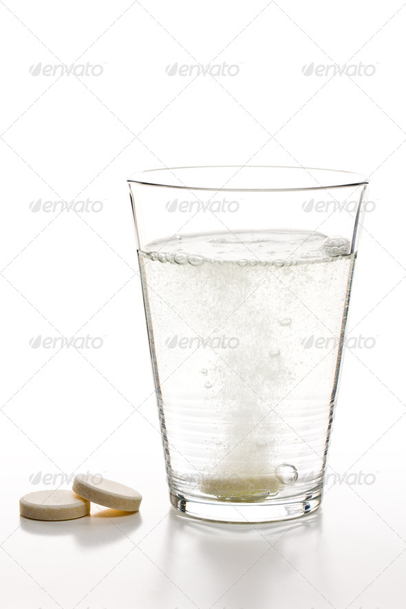 effervescent tablets and glass with water - Stock Photo - Images