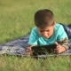 Boy Playing On The Lawn With a Tablet - VideoHive Item for Sale