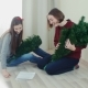 Two Young Girl Preparing Christmas Tree For Decorations And Having Fun New Year - VideoHive Item for Sale