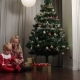 Little Boy And Girl Opening Presents On Christmas - VideoHive Item for Sale