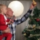Grandfather With Boy Decorating Christmas Tree - VideoHive Item for Sale