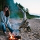Girl Sitting Near The Fire Camp - VideoHive Item for Sale