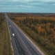 Flying Over The Road Among The Autumn Forest - VideoHive Item for Sale