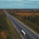 Aerial View Road And Autumn Forest - VideoHive Item for Sale