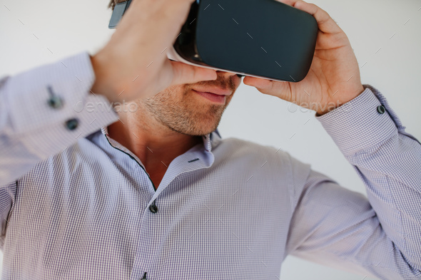 Male model wearing VR goggle - Stock Photo - Images