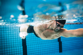 Professional male athlete swimming in pool - PhotoDune Item for Sale