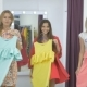 Three Cute Girls Demonstrate Dresses In Showroom - VideoHive Item for Sale