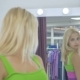 The Girl Looking At The Mirror In The Showroom - VideoHive Item for Sale