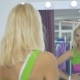 Girl In New Dress Looking In Mirror In Showroom - VideoHive Item for Sale