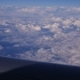 View Through An Airplane Window In The Blue Sky In Clouds - VideoHive Item for Sale