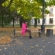 Young Girl In Pink Coat With Laptop On Bench In University Park - VideoHive Item for Sale
