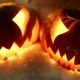 Halloween Pumpkins In The Winter Snowy Night With Overflying Ghost. Looped - VideoHive Item for Sale