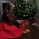 Woman Putting Gift Boxes Under Christmas Tree - VideoHive Item for Sale