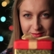 Happy Young Woman Holding Christmas Present Box - VideoHive Item for Sale