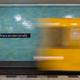 Yellow subway train in motion on Berlin Alexanderplatz underground station. - PhotoDune Item for Sale