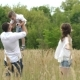 Happy Family Walking Outdoor. Parents Hold Child On Hands And Rejoice - VideoHive Item for Sale