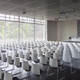 Empty white chairs in contemporary conference hall with - PhotoDune Item for Sale