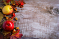 Border of apples, red berries and fall leaves on the rustic wood - PhotoDune Item for Sale