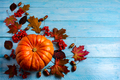 Thanksgiving background with ripe orange pumpkin on blue wooden - PhotoDune Item for Sale