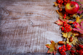 Border of ripe fruits and fall leaves on the dark wooden backgro - PhotoDune Item for Sale