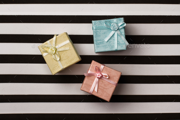 small gift boxes on stripes paper background - Stock Photo - Images