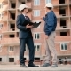 Men Discussing The Building Plan At Construction - VideoHive Item for Sale