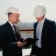 Two Men In Helmet Talk At The Roof - VideoHive Item for Sale