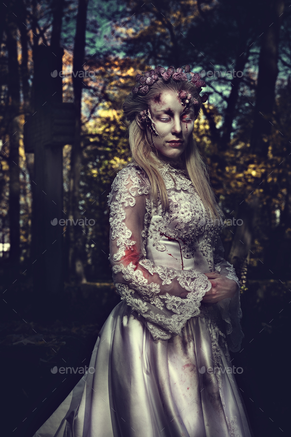 Dressed in wedding clothes romantic zombie woman. - Stock Photo - Images