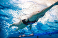 Professional female athlete swimming in pool - PhotoDune Item for Sale