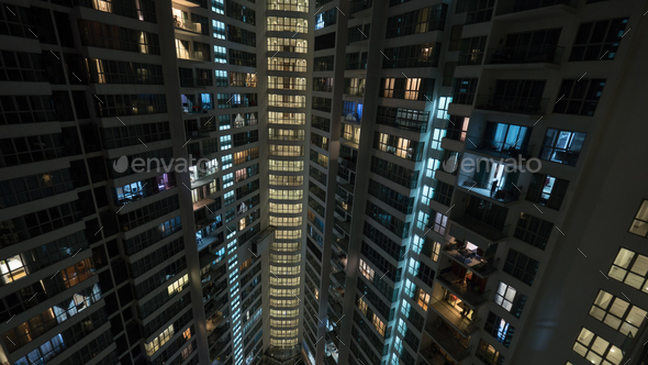 Window lights in multistorey house at night, Kuala Lumpur - Stock Photo - Images