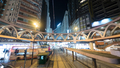 Illuminated street of Hong Kong with rails and pedestrian bridge - PhotoDune Item for Sale