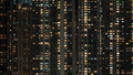 Window lights in high-rise apartment block at night - PhotoDune Item for Sale