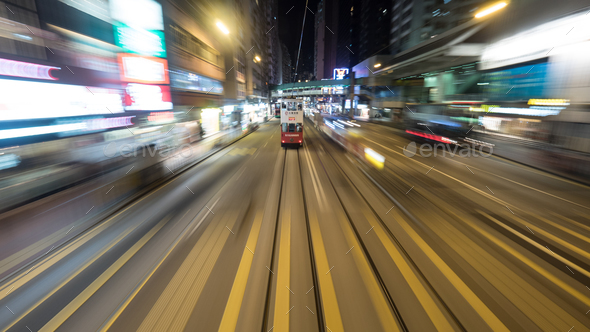 Double-decker tram on night road of Hong Kong - Stock Photo - Images