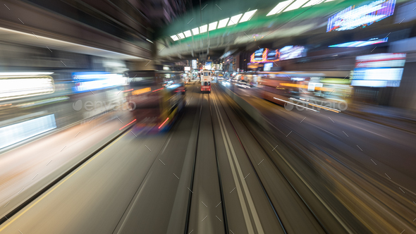 Traveling by tram in Hong Kong at night - Stock Photo - Images