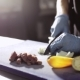 Hands Of Chef In Gloves Cutting An Onion In Commercial Kitchen - VideoHive Item for Sale