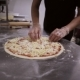 Chef Putting Cheese Topping On His Pizza Base - VideoHive Item for Sale