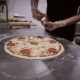Chef Making Italian Pizza. Hands of Chef Add the Ingredients in The Pizza - VideoHive Item for Sale