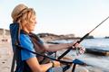 Teenage boy fishing at sea - PhotoDune Item for Sale
