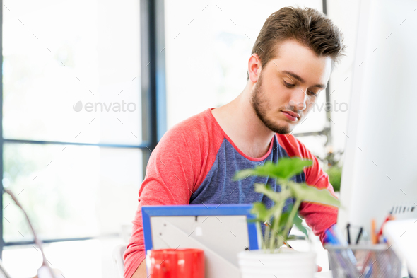 Young man working in office - Stock Photo - Images