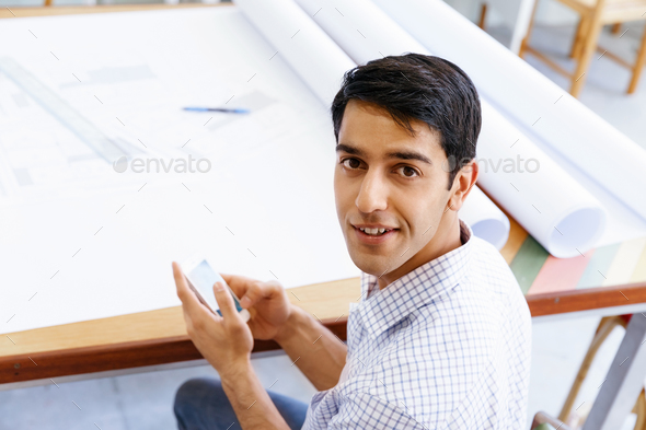 Young man architect in office - Stock Photo - Images