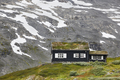 Traditional norwegian mountain landscape with black wooden house. Travel Norway. Horizontal - PhotoDune Item for Sale