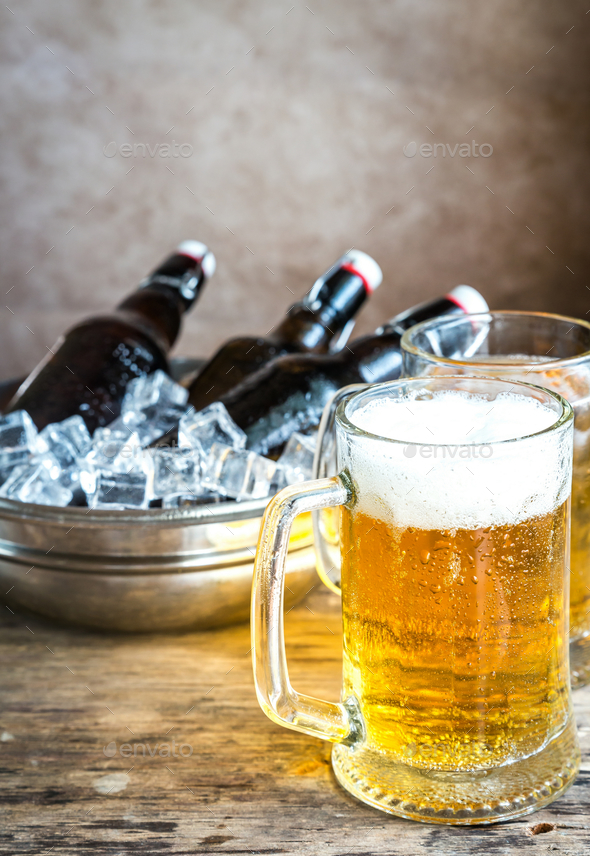 Grilled sausages and mugs of beer - Stock Photo - Images