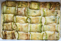 Baked zucchini rolls stuffed with cheese