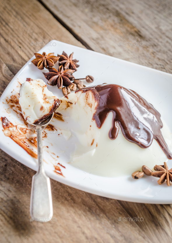 Panna cotta under chocolate topping - Stock Photo - Images