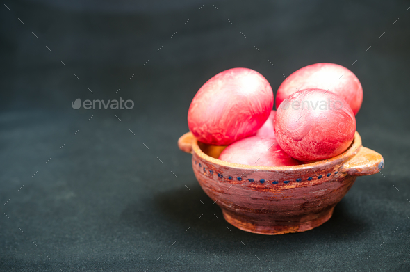 Colorful eggs in clay bowl - Stock Photo - Images