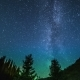 The Milky Way Rises Over The Pine Trees On a Foreground. - VideoHive Item for Sale