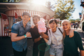 Group of young friends with cotton candy in amusement park - PhotoDune Item for Sale