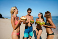 Friends drinking fresh coconut water by the sea - PhotoDune Item for Sale
