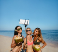 Female friends taking selfie on the beach - PhotoDune Item for Sale